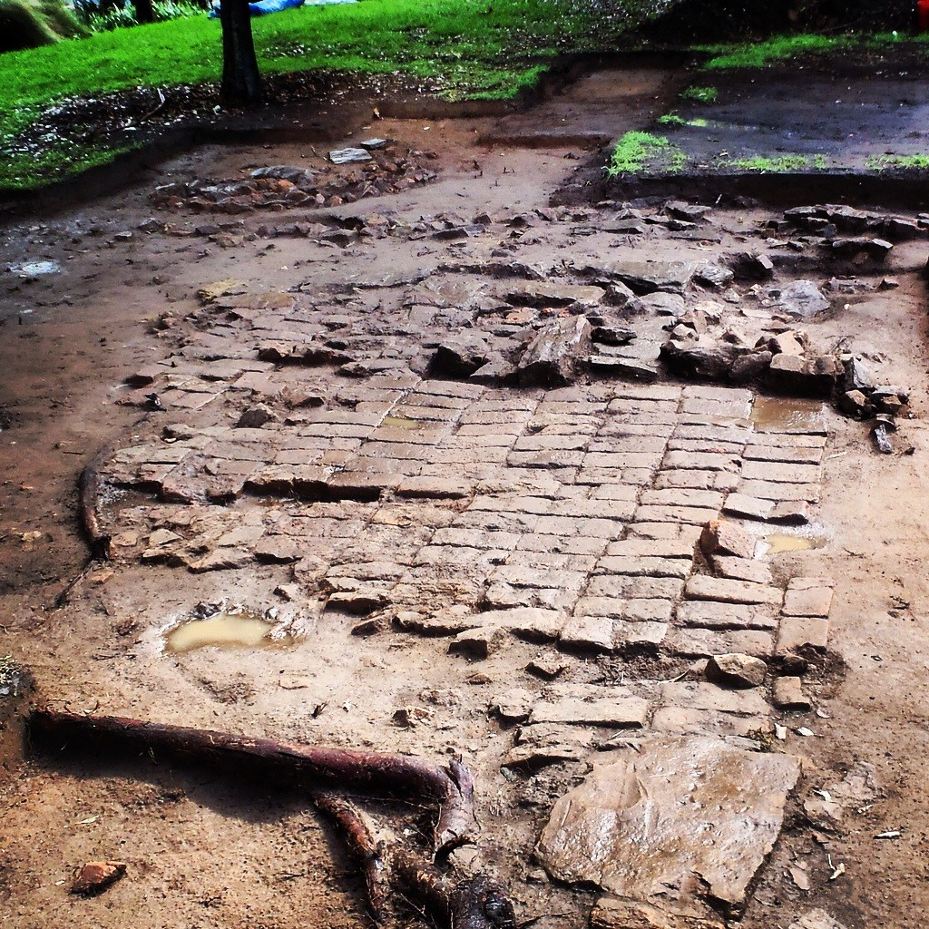 "Remains of a 1790s convict hut floor, at present-day Murray Gardens, Parramatta Park. This hut was one of many that once lined ""High Street"" later renamed ""George Street."" Photo by John McAlister Cameron (2015)."